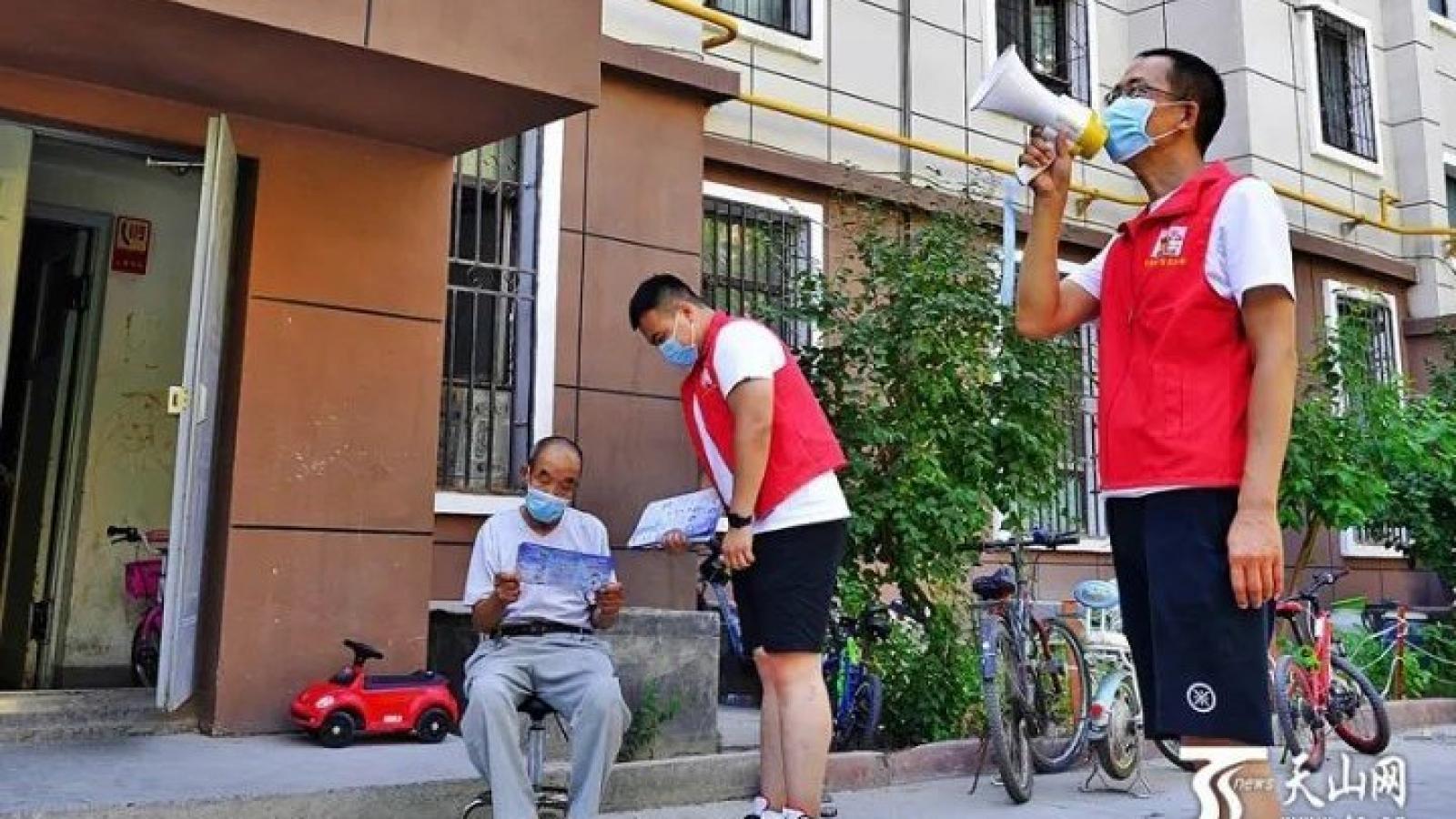 Covid-19 ở Trung Quốc: Nơi xét nghiệm toàn thành phố, nơi hạ cảnh báo