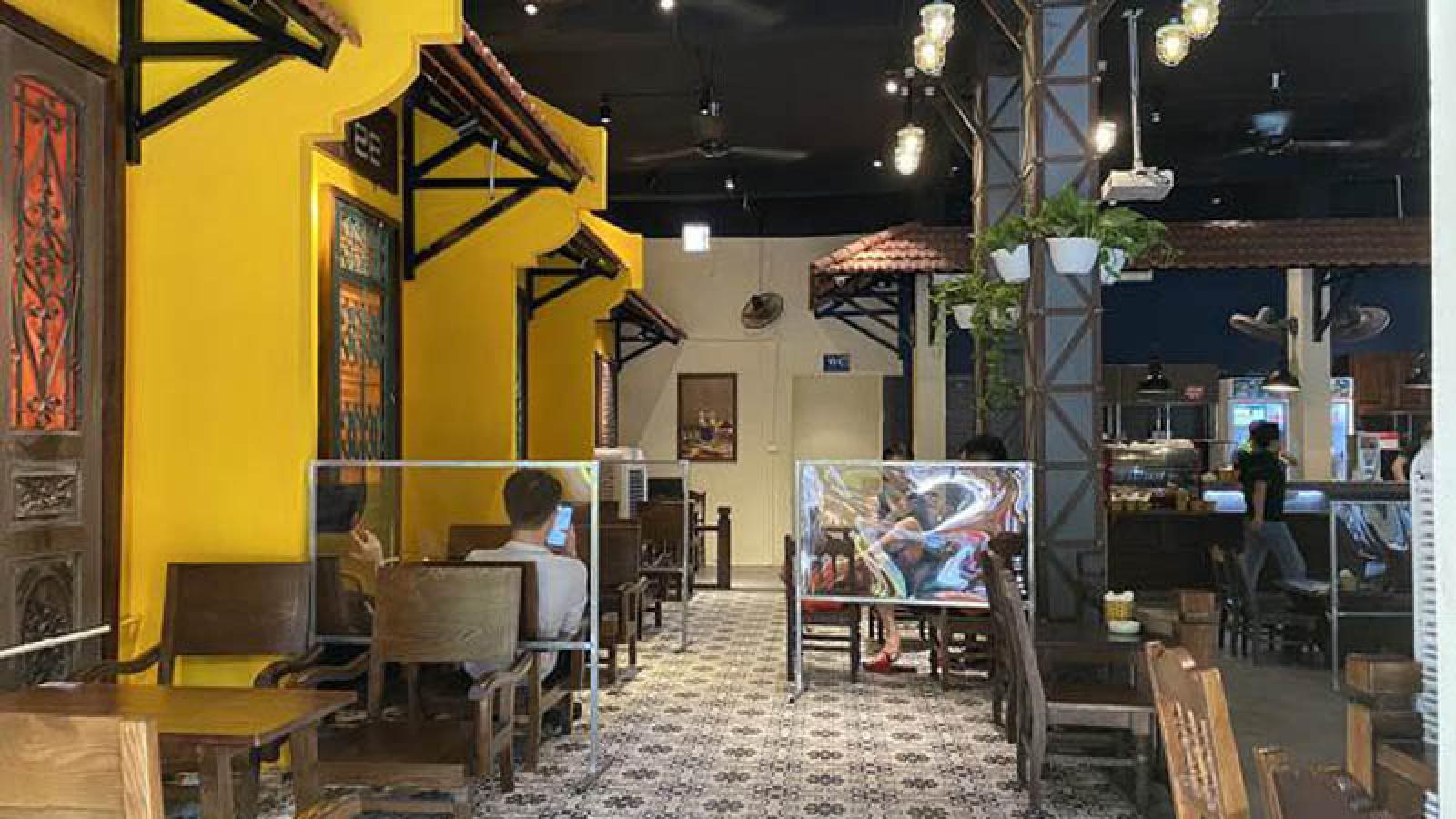 Hanoi cafes seek to follow social distancing measures