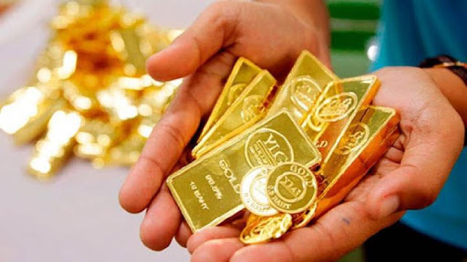 Giá vàng giảm trước áp lực tăng của đồng USD
