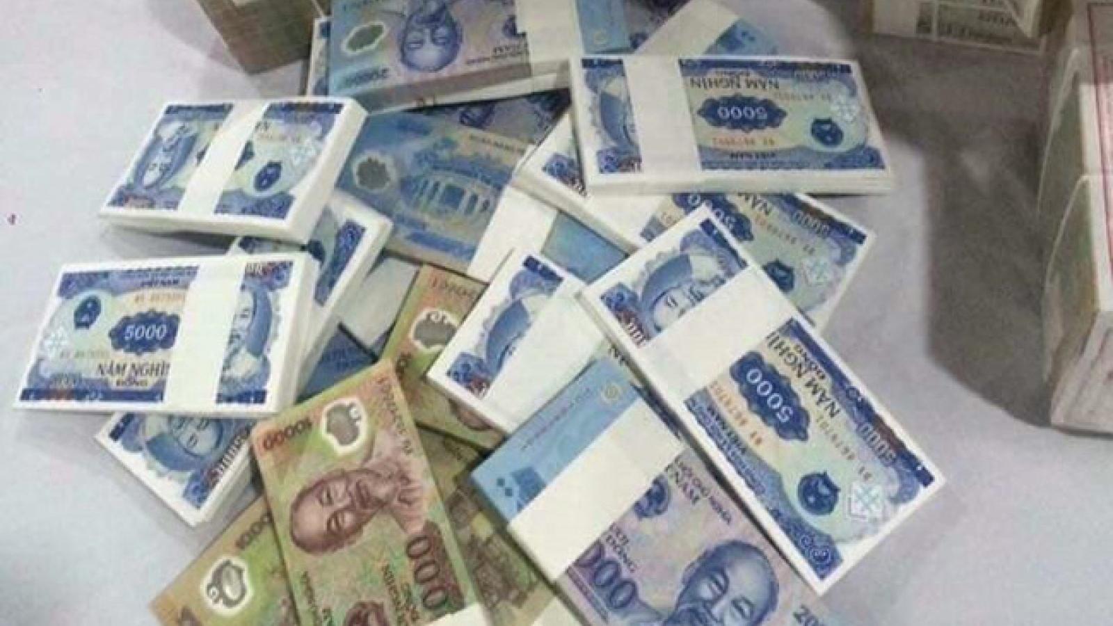 Đổi tiền mới trên mạng lấy phí có thể bị phạt đến 40 triệu đồng