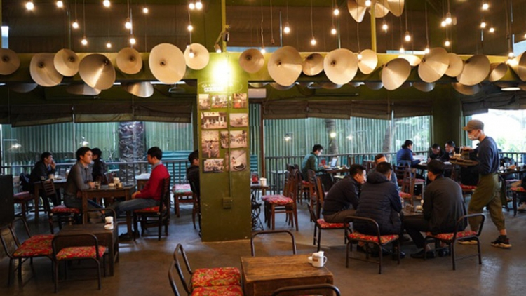 Hanoi coffee shops busy after reopening on March 2