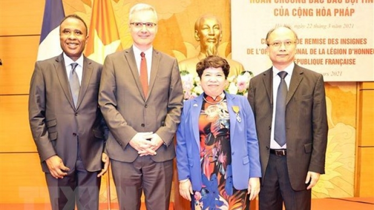 NA official receives France's National Order of the Legion of Honour