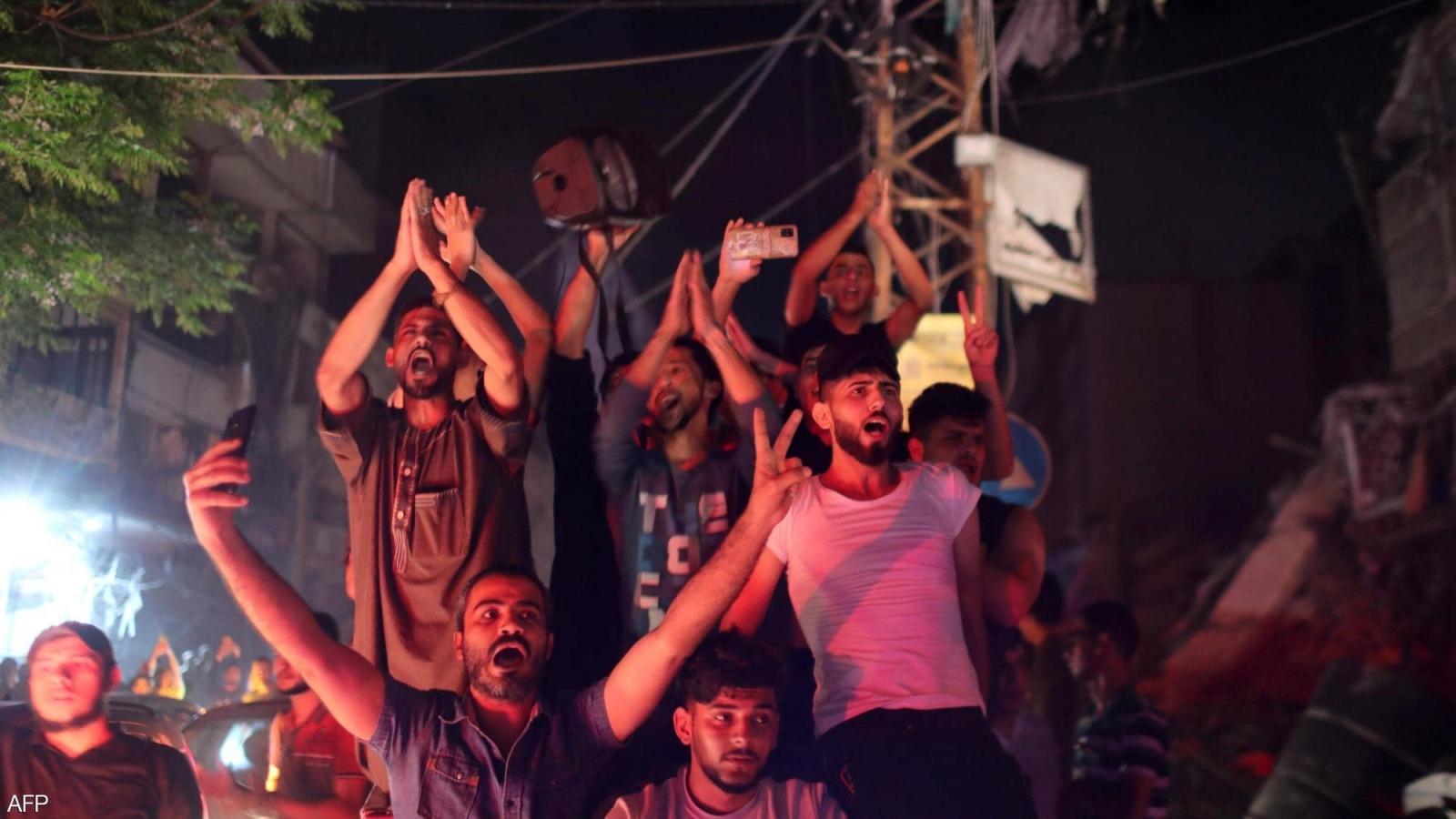 Người dân Palestine ăn mừng sau khi lệnh ngừng bắn có hiệu lực