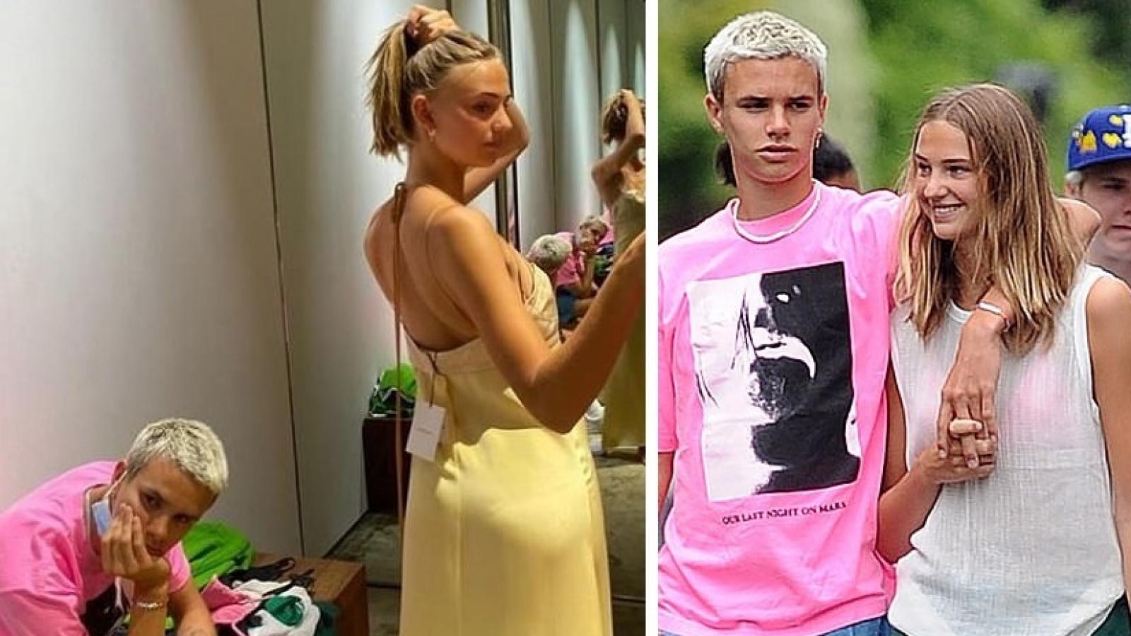 """Con trai Victoria Beckham """"buồn chán"""" chờ bạn gái thử đồ tại cửa hàng thời trang của mẹ"""