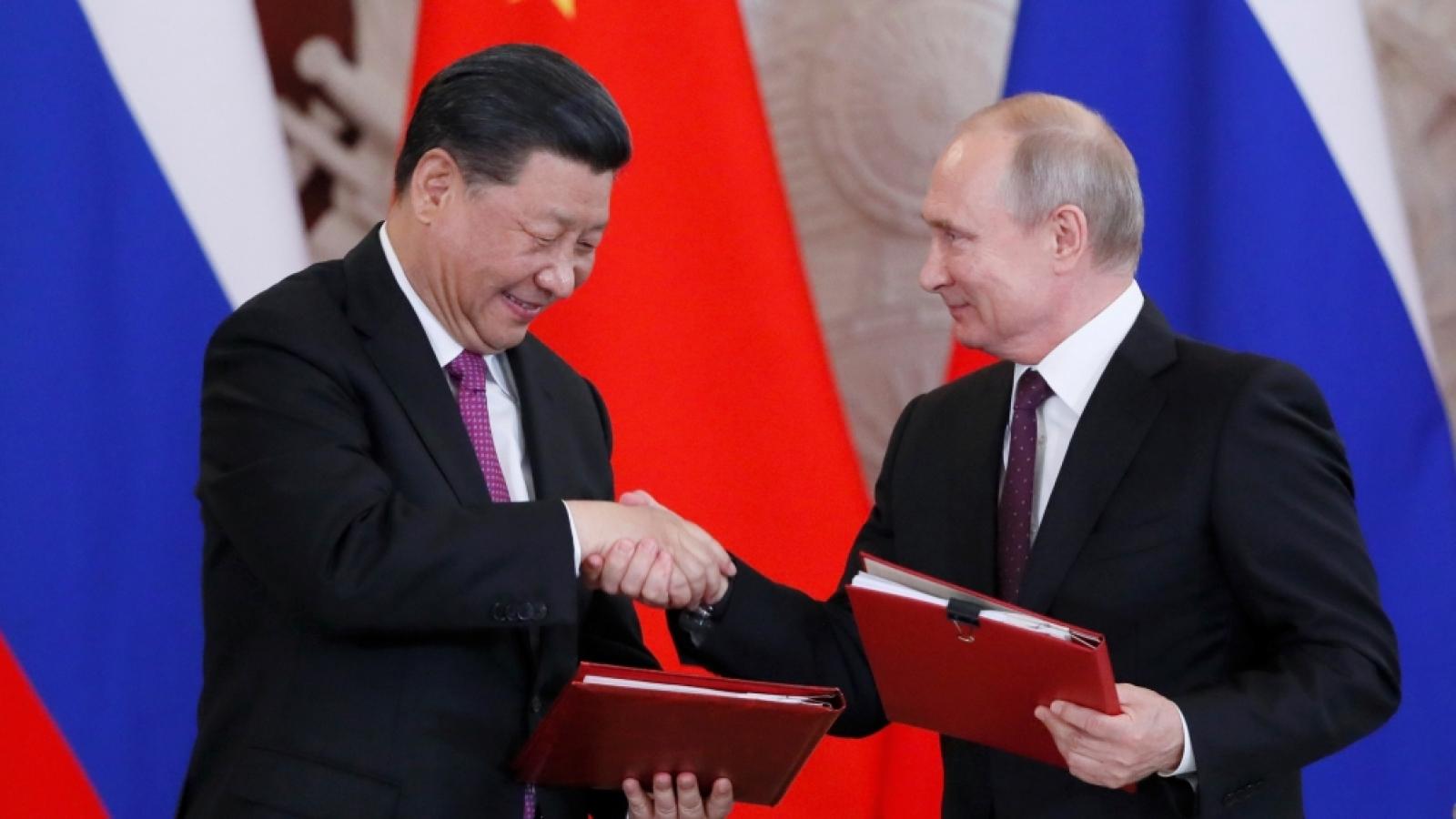Gia hạn Hiệp ước hữu nghị, Nga-Trung bắt tay gửi thông điệp tới Mỹ
