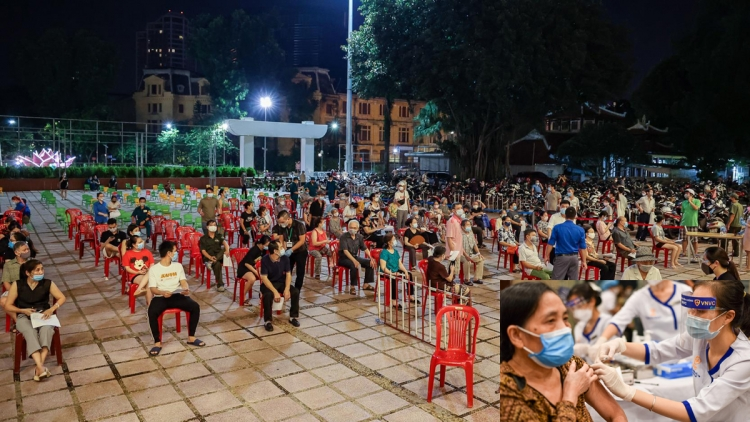 Hanoi residents stay overnight for COVID-19 vaccination
