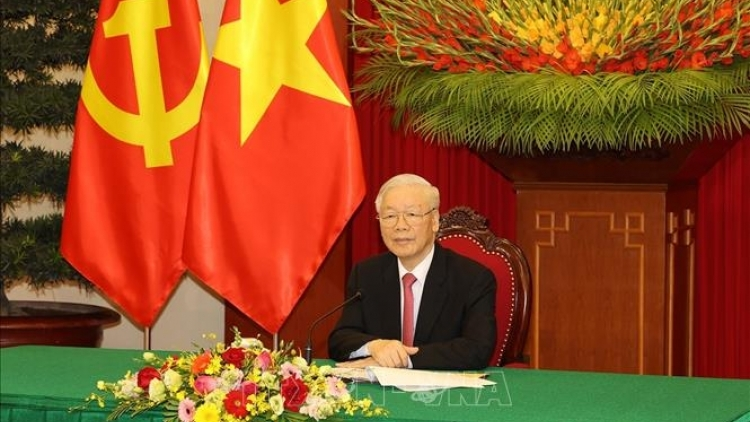 Vietnam, China to enhance substantive cooperation, say top leaders