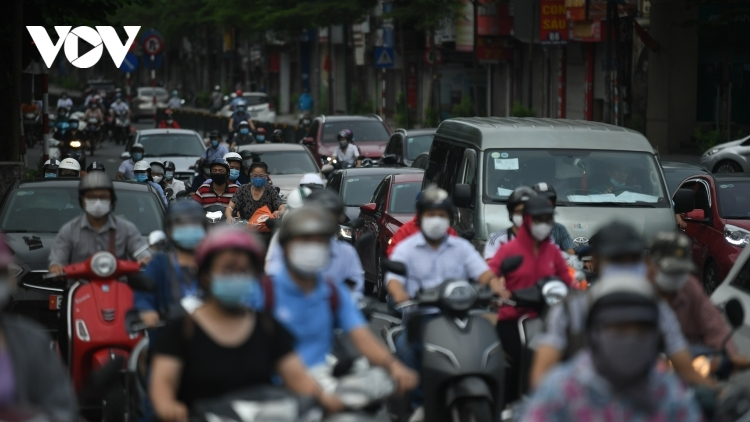 People in Hanoi take to streets after lockdown restrictions eased