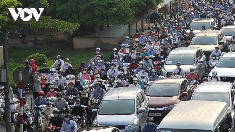 Hanoi streets busy on first day of COVID-19 restrictions being eased