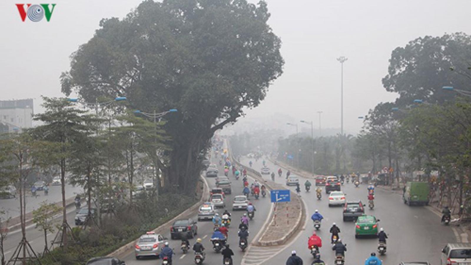 Dense fog fills Hanoi streets