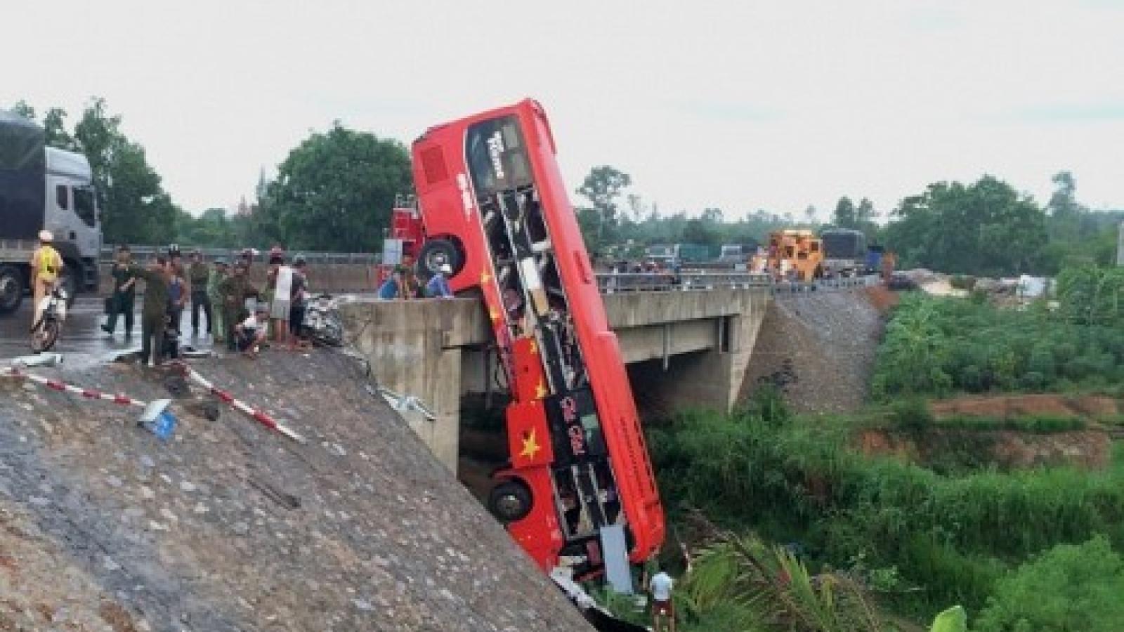 One dead, ten injured as passenger bus climbs up bridge