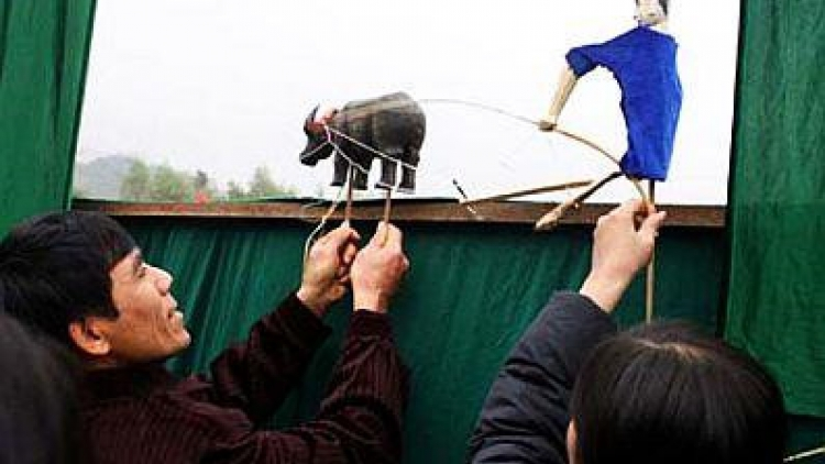 Stick puppetry of the Tay