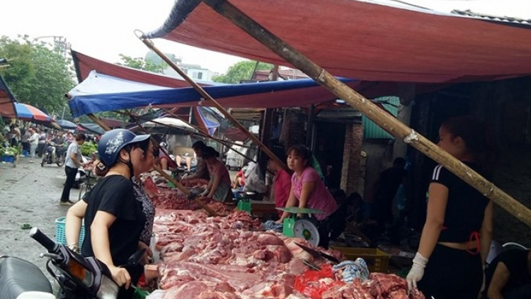 Firms promote pork demand, farmers struggle