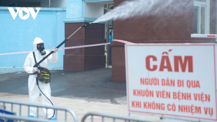 Military forces spray disinfectant at K Hospital's Tan Trieu medical facility