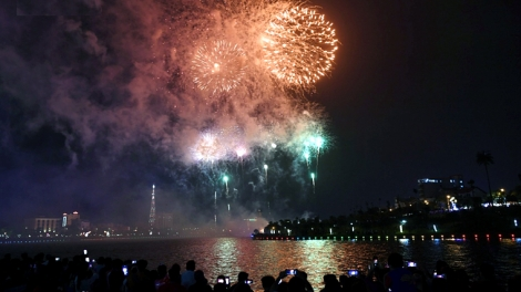 Fireworks light up night sky as people commemorate founders of nation