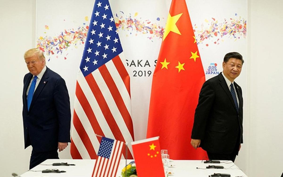 Tổng thống Donald Trump (trái) và Chủ tịch Tập Cận Bình tại hội nghị G20 ở Osaka, Nhật Bản, tháng 6/2019. Ảnh: Reuters.