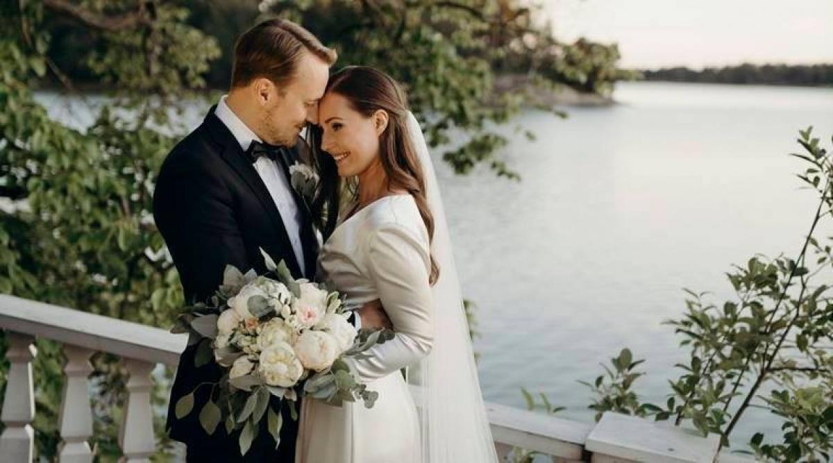 Thủ tướng Phần Lan Marin và hôn phu Raikkonen. Ảnh: AP