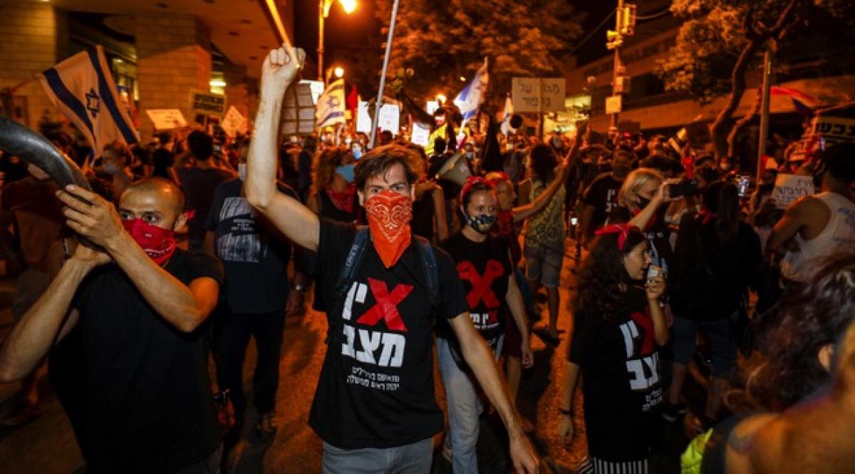 Đám đông người biểu tình phản đối Thủ tướng Israel tại thành phố Jerusalem. Ảnh: AFP.