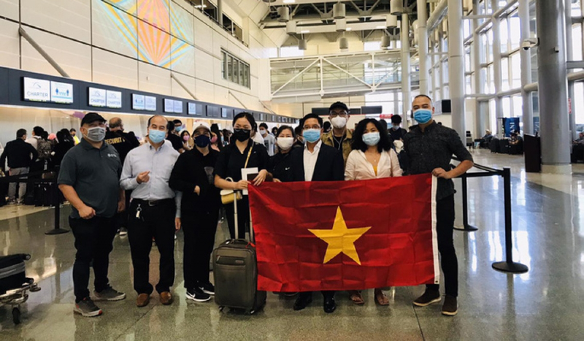 Vietnamese citizens pose for a photo before their depature