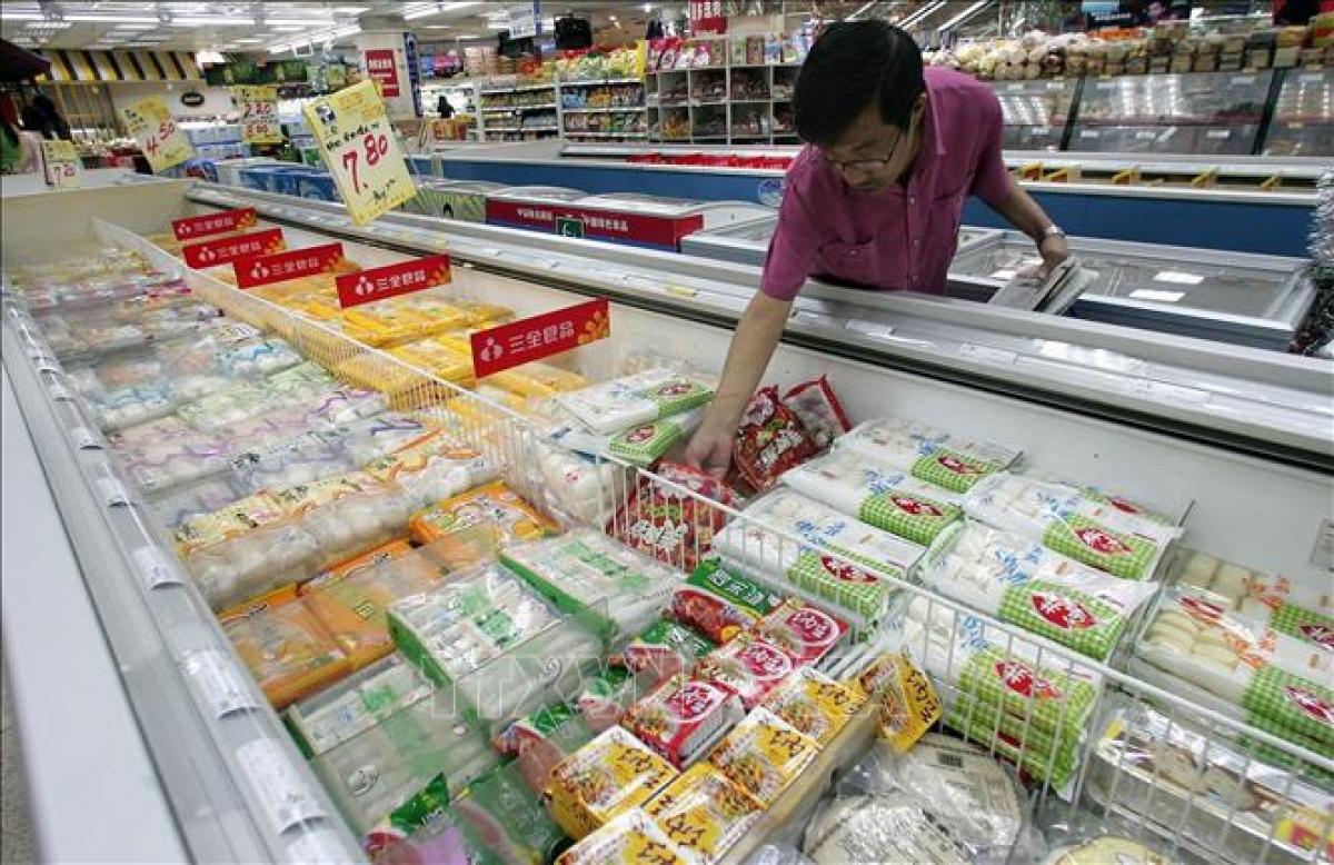 Thực phẩm đông lạnh được bày bán tại siêu thị ở Bắc Kinh, Trung Quốc. Ảnh: AFP/TTXVN