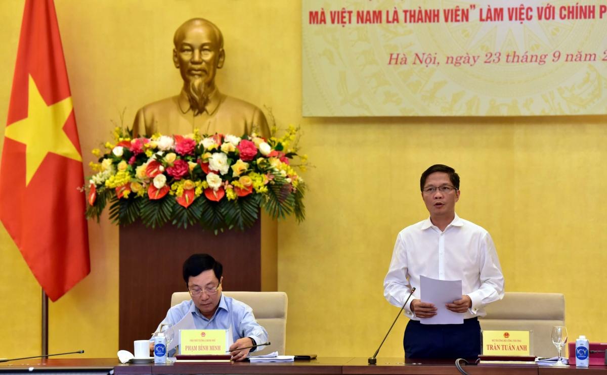Bộ trưởng Bộ Công Thương Trần Tuấn Anh báo cáo về tình hình thực hiện các Hiệp định FTA mà Việt Nam là thành viên. (Ảnh: Bộ Công Thương)