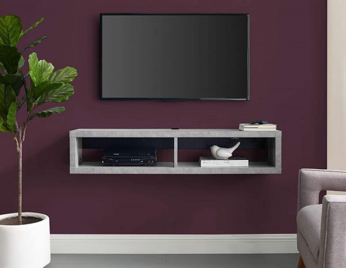 Không phải bằng gỗ hoặc kính, một chiếc kệ tivi bằng bê tông nhẹ khiến căn phòng khách thật đặc biệt.