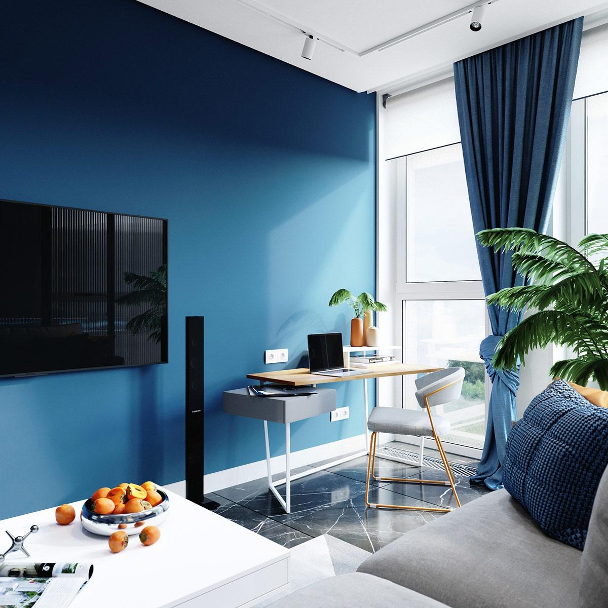 Bức tường màu xanh tiếp tục phía sau bàn làm việc tại nhà.