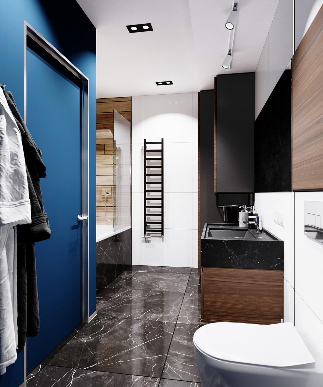 Sàn đá cẩm thạch cung cấp vẻ ngoài sang trọng cho phòng tắm.