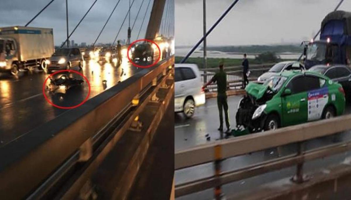 Sau cú tông trực diện với xe máy, chiếc taxi bị bẹp phần đầu xe. (Ảnh: CTV)