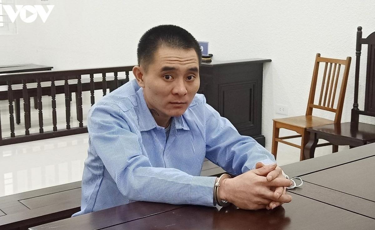 Bị cáo Lê Đăng Long vừa bị tuyên phạt 13 năm tù vì tham gia đường dây giả danh công an lừa đảo qua điện thoại. (Ảnh: Trọng Phú)