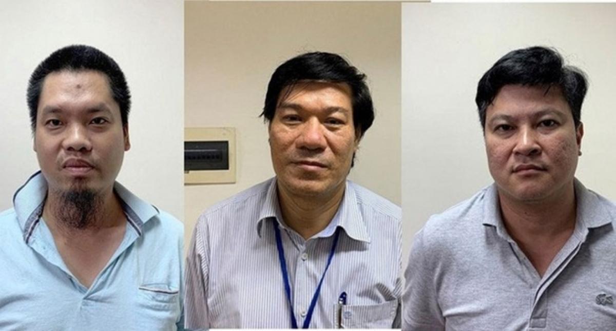 Cựu giám đốc CDC Hà Nội - Nguyễn Nhật Cảm (giữa) và đồng phạm.
