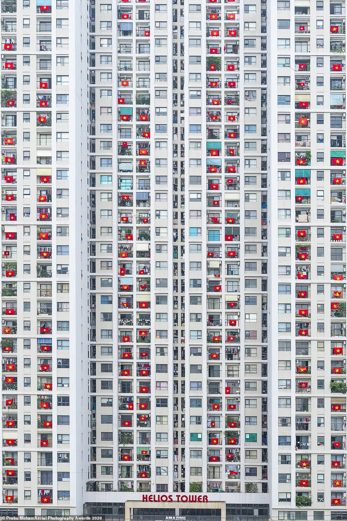 Among the World in Lockdown category a photo taken by Indian photographer Prabu Mohan was picked out by judges. He said, 'It is a residential apartment near my home [in Vietnam]. The residents hang their Vietnam national flags in support of those who are fighting on the front line against coronavirus.'