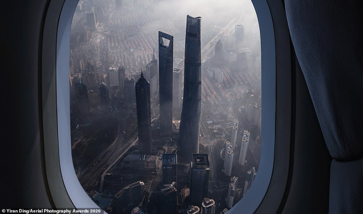 Chinese photographer Yiran Ding claims first prize in the Travel category for his photo of Shanghai as seen through an airplane window.