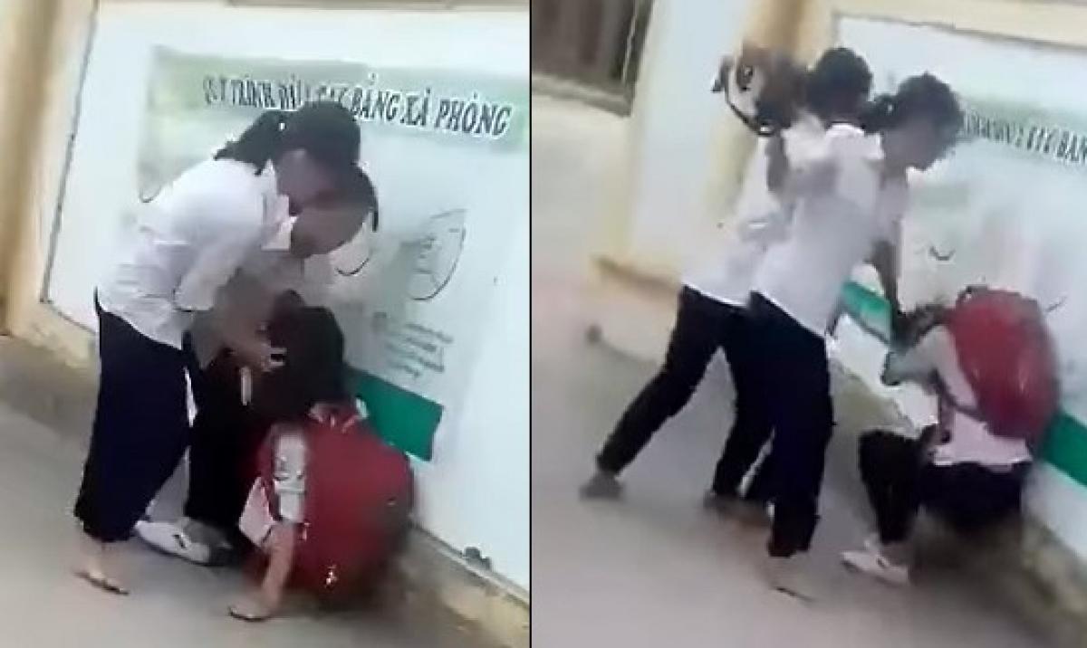 Nữ sinh bị nhóm bạn đánh đập (ảnh cắt từ clip).