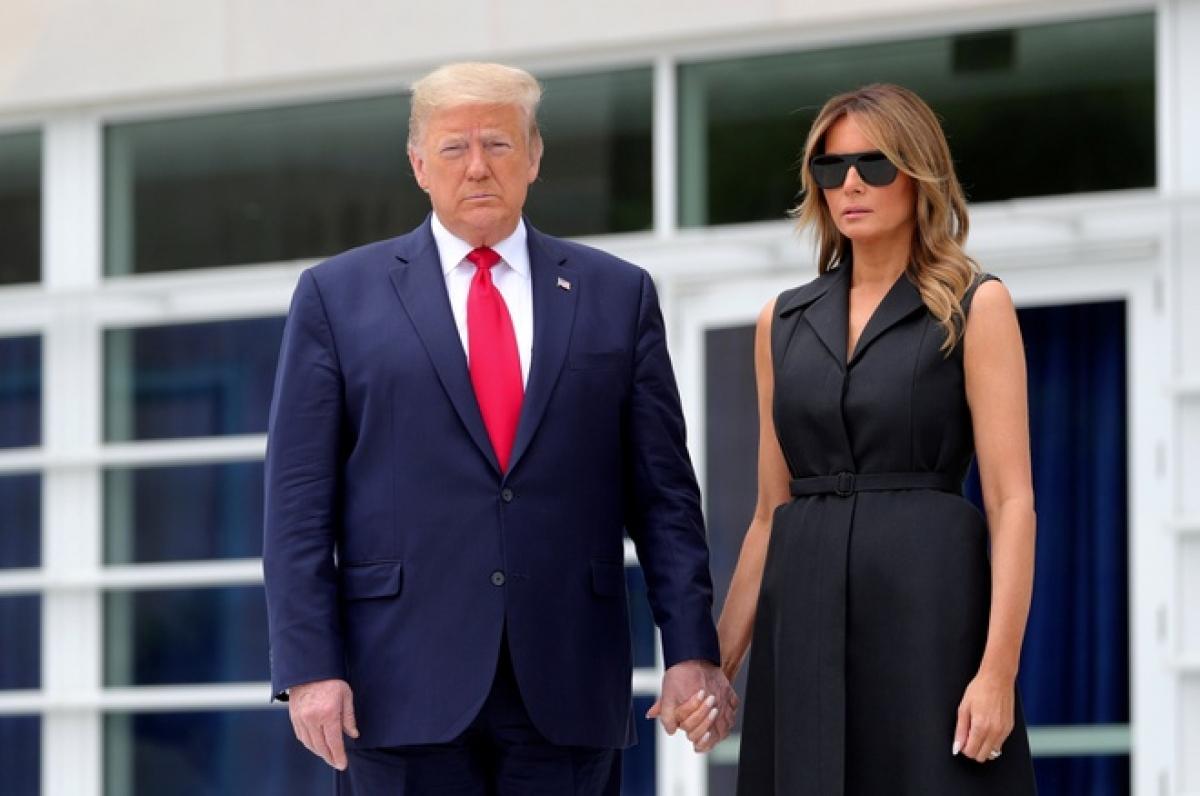 Tổng thống Trump và phu nhân Melania Trump đều mắc Covid-19. Ảnh: Reuters