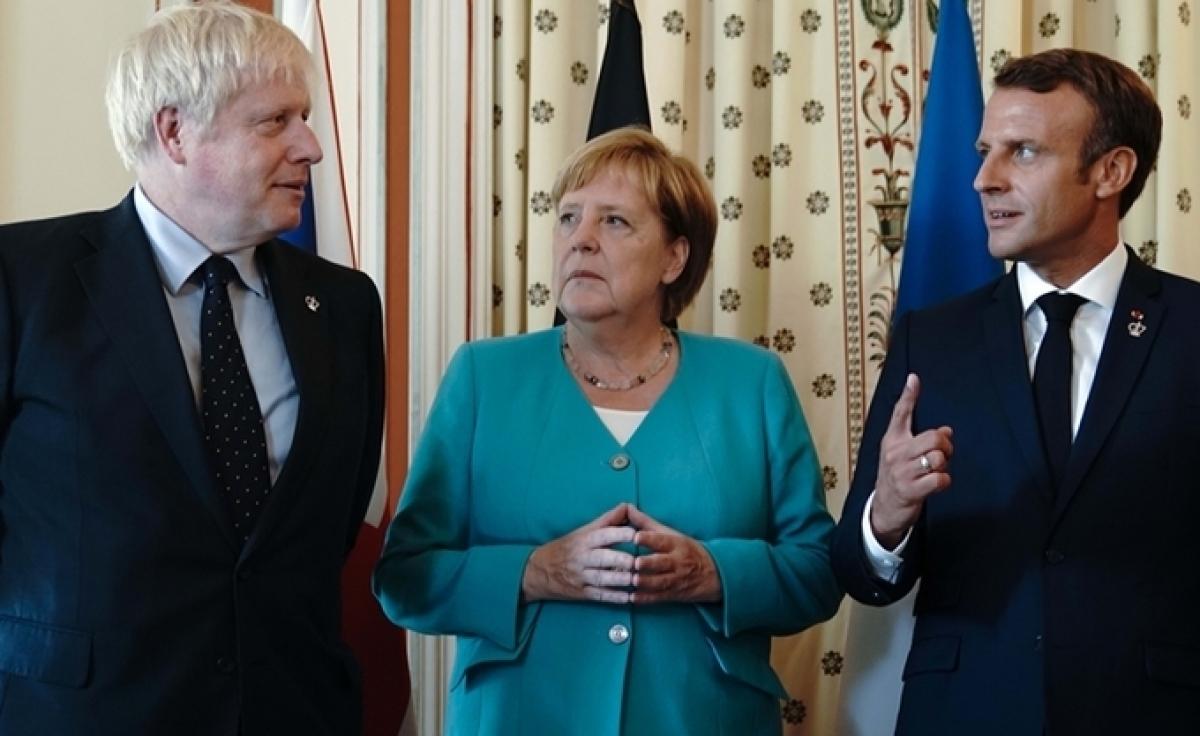 Từ trái qua phải: Thủ tướng Anh Boris Johnson, Thủ tướng Đức Angela Merkel và Tổng thống Pháp Emmanuel Macron. (Ảnh minh họa: Reuters).