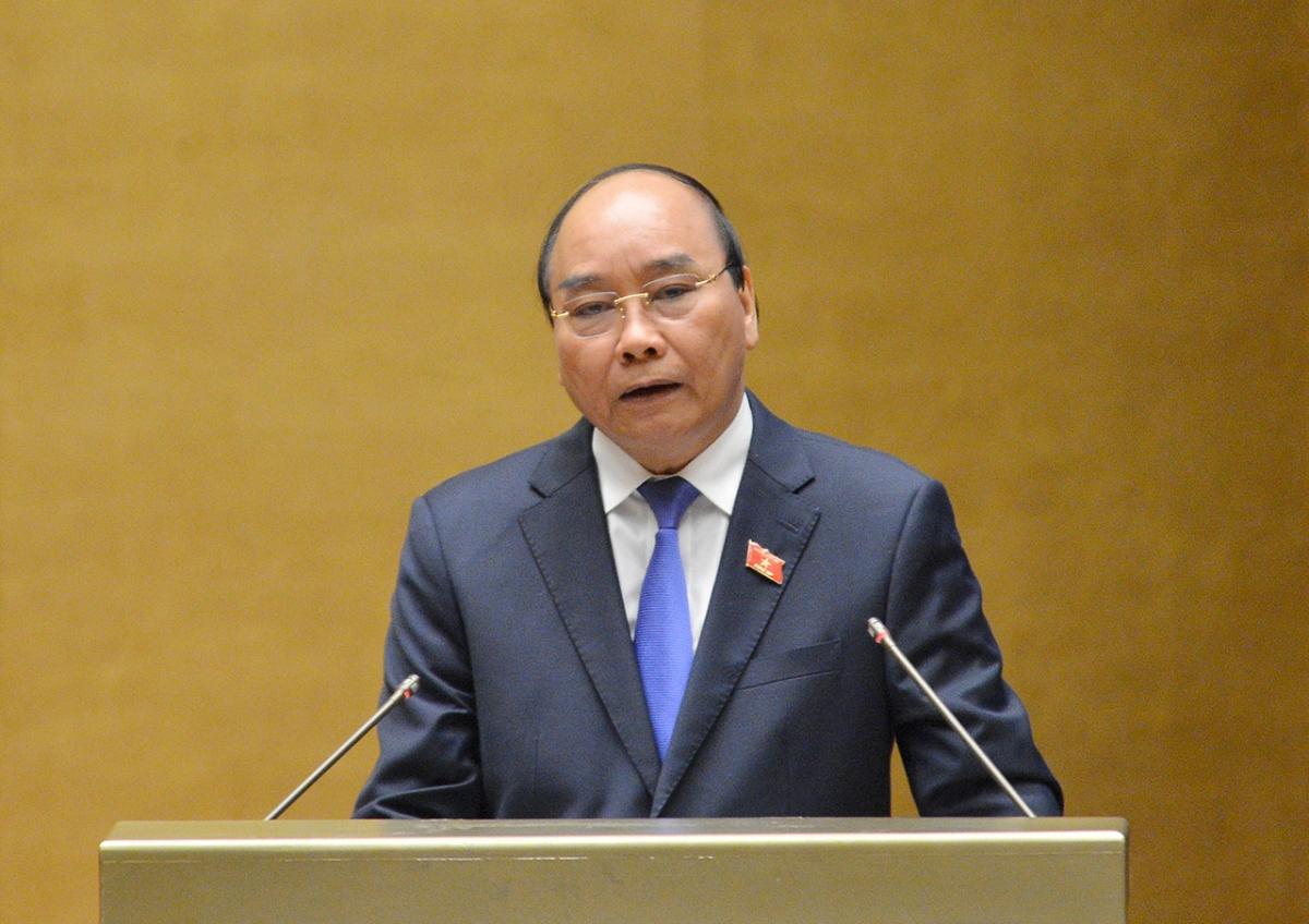 Thủtướng Chính phủ Nguyễn Xuân Phúc trả lời chất vấn trước Quốc hội. Ảnh: Quochoi.vn