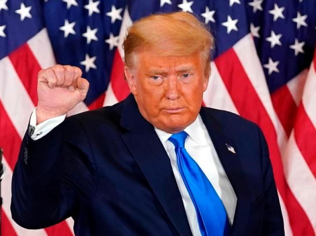 Với 3 phiếu đại cử tri của bang Alaska, Tổng thống Donald Trump hiện có 217 phiếu đại cử tri. Hơn 71 triệu người dân đã bầu cho đương kim tổng thống trong cuộc bầu cử 2020. Ảnh: Reuters.