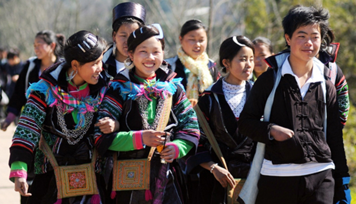 Mong boys and girls wear traditional clothing to festivals