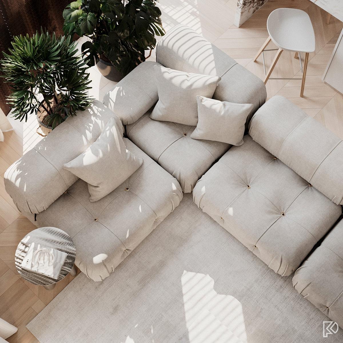 Chiếc sofa lớn màu xám cùng tông với thảm giúp tô điểm thêm cho phòng khách hiện đại.