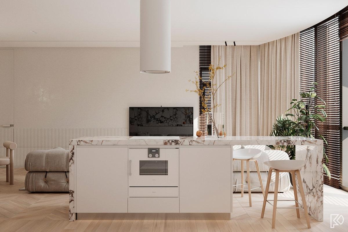 Đá cẩm thạch một lần nữa được ốp bàn bếp mang lại sự quyến rũ, sang chảnh cho không gian bếp.