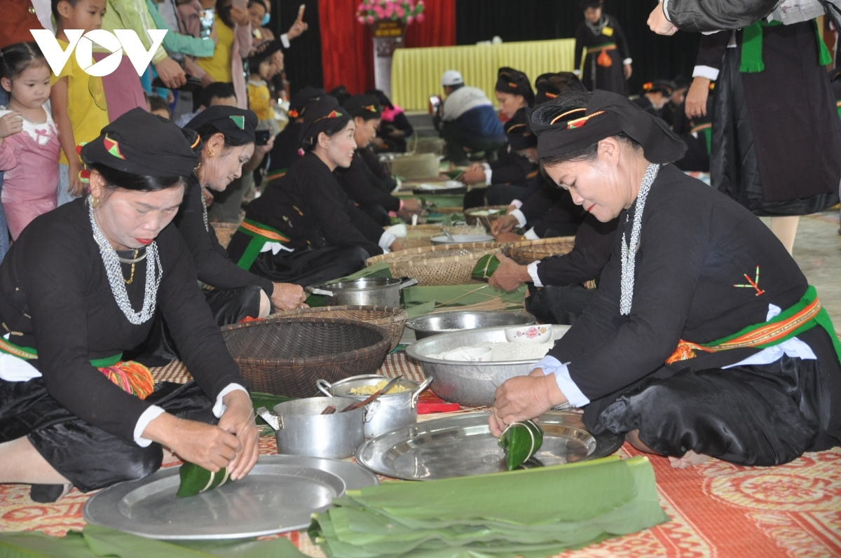 Cooking Banh chung gu, a square sticky rice cake, is a traditional activity of the annual festival.