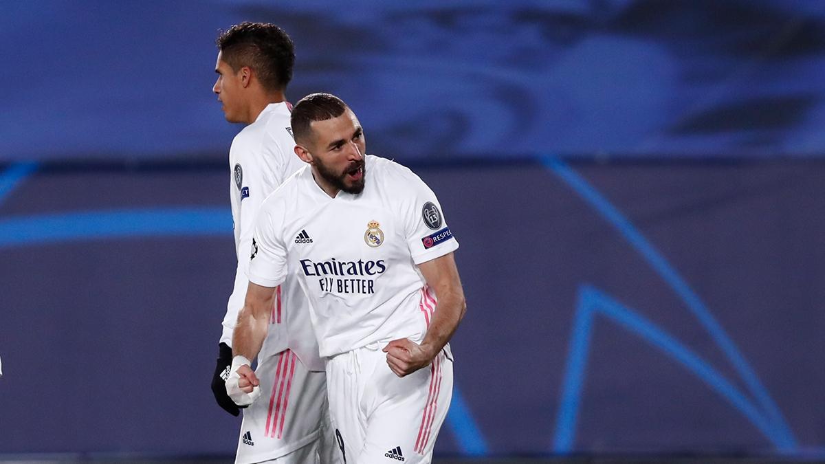Benzema tỏa sáng giúp Real Madrid giành vé vào vòng 1/8 Champions League 2020/2021 (Ảnh: Getty).