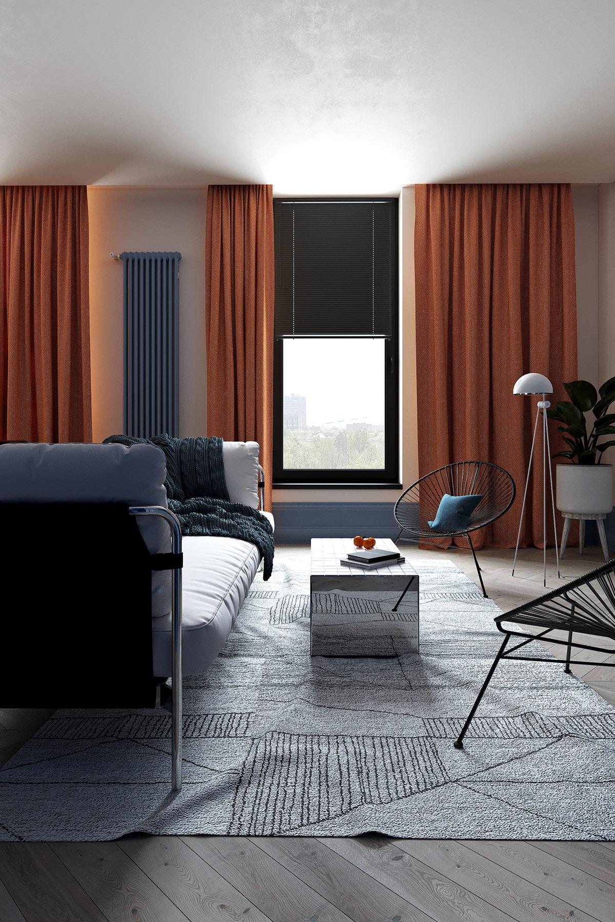 Những chiếc rèm màu cam giúp không gian phòng khách trở nên ấm cúng trong tiết trời lạnh giá và việc đan xen màu xanh dương dường như giúp căn phòng được dịu nhẹ hơn.
