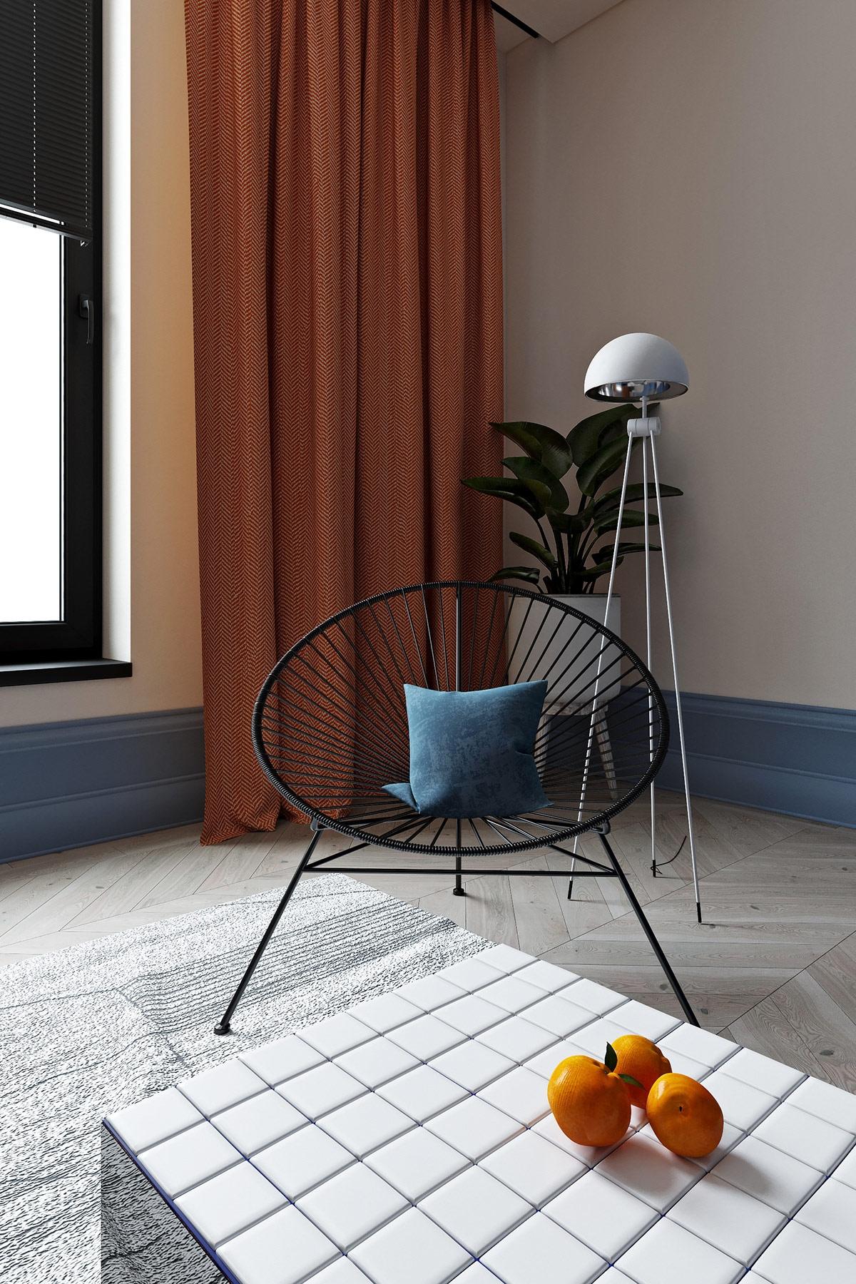Chiếc ghế ngồi thư giãn, đọc sách khá ấn tượng cùng chiếc gối ôm màu xanh dương.