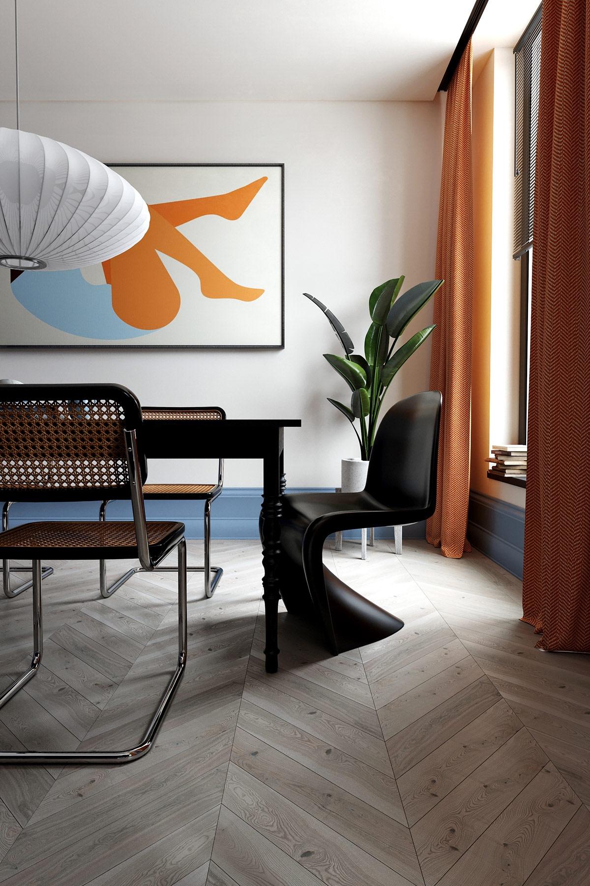 Bức tranh treo tường trừu tượng đi kèm với bộ bàn ăn tối màu mang lại sự thú vị, hấp dẫn trong không gian phòng ăn.