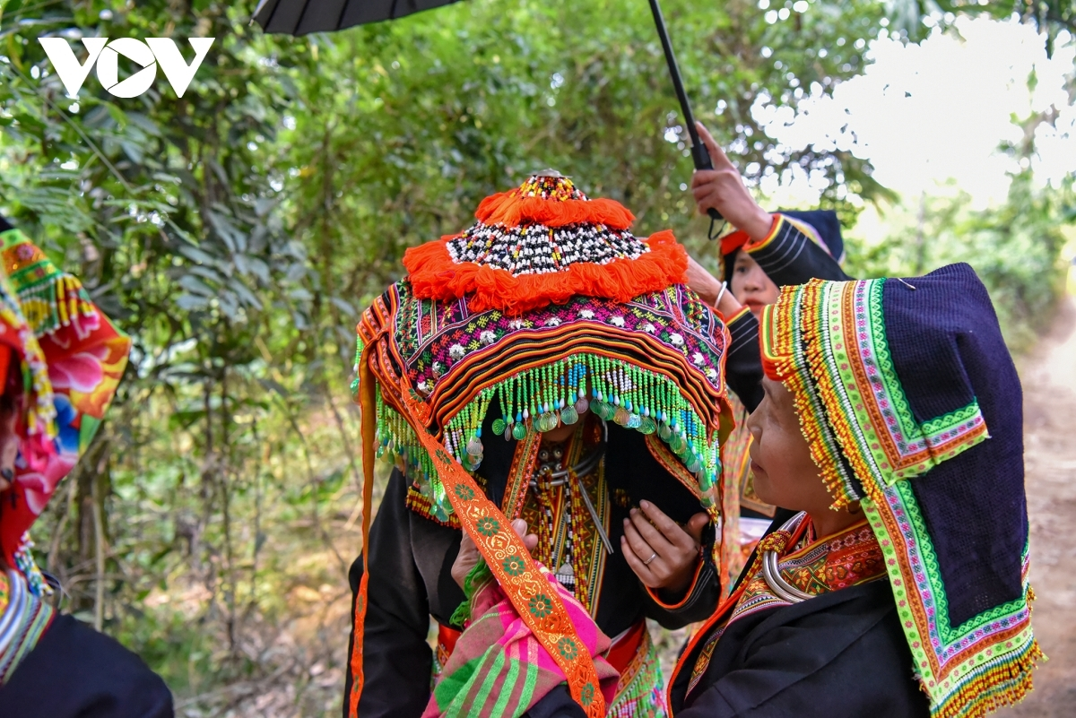 An old woman is on hand to guide the bride in following the various customs of the bridegroom.