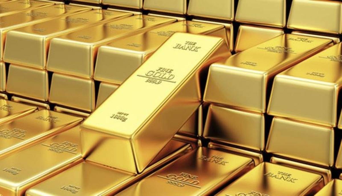 Giá vàng SJC và vàng thế giới tăng mạnh (Ảnh minh họa: KT)