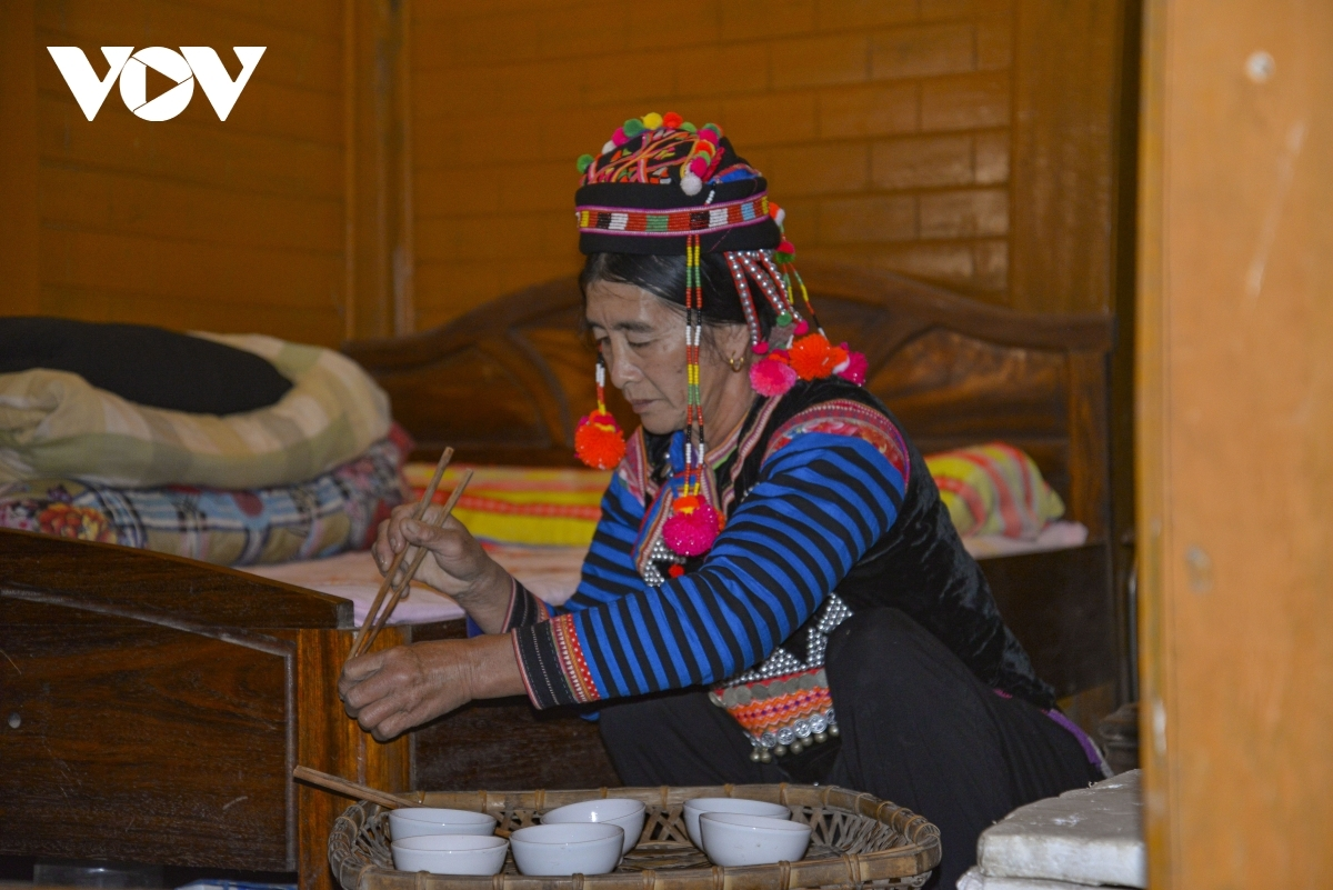 A Ha Nhi ethnic woman prepares offerings to the ancestors on the first day of the new year festival.
