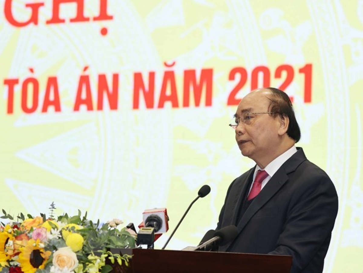 Prime Minister Nguyen Xuan Phucspeaks at the teleconference. (Photo: VNA)